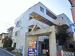 東京都多摩市馬引沢1の賃貸マンションの外観