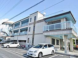 大阪府交野市東倉治4丁目の賃貸マンションの外観