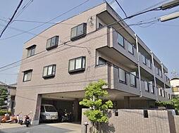 大阪府交野市倉治3丁目の賃貸マンションの外観