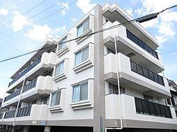 大阪府四條畷市雁屋西町の賃貸マンションの外観