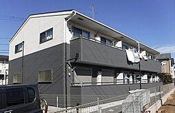 コーモド飯山満[101号室号室]の外観