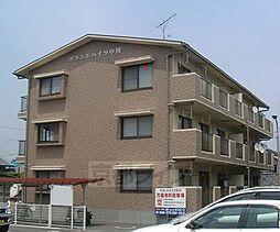京都府京田辺市田辺沓脱の賃貸マンションの外観